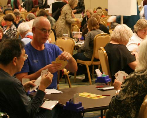 players at duplicate bridge tournament